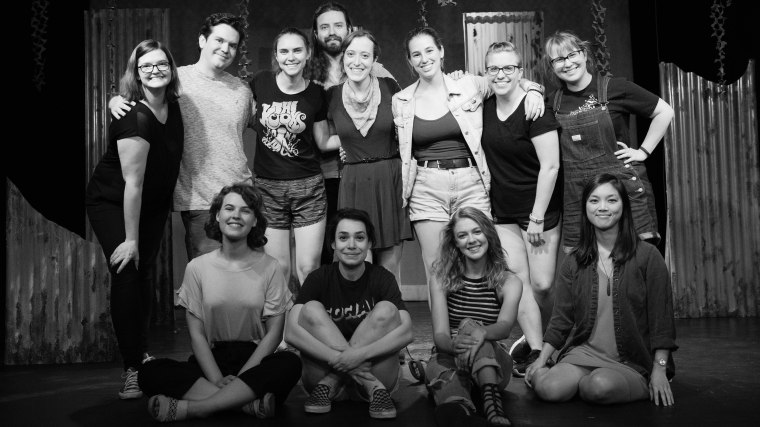 Top row, right to left: Lindsey McGowen (Lighting Designer), Chris Anderson (Stage Manager), Marian Kansas (Director & Producer), Keith Adam Paxton (The Hunter), Nicole Oglesby (Playwright & Producer), Katy Matz (Dramaturg & Producer), Cindy Page (Costume Designer), Amanda Perry (Set & Props Designer). Bottom row, right to left: Kenzie Stewart (Peg), Franny Harold (Willa), Laney Neumann (Margot), Christabel Lin (Composer & Violinist). Photo by Daniel Ellsworth.